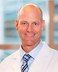 Derek Moore, MD